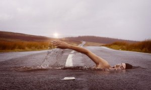 strange dream example shown in a person swimming through the asphalt of the road